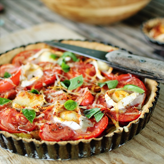 Sweet onion and tomato tart and horses in custody